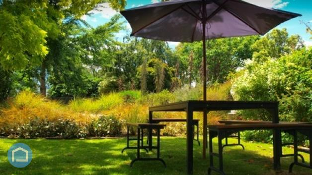 outdoor dining table with umbrella